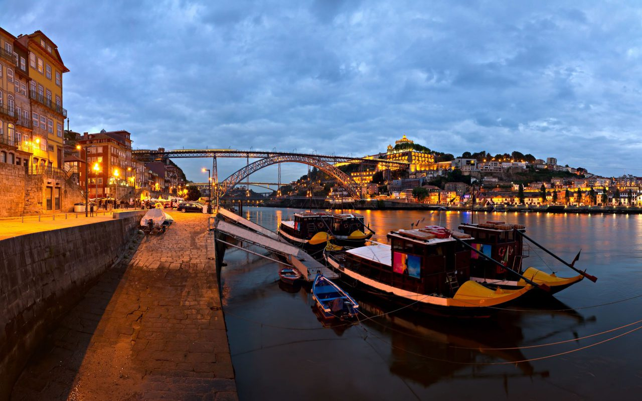 Visit-Portugal-panorama-old-Porto-river-Duoro-Vintage-Port-Transporting-Boats-Old-Town-Town-of-Gaia-and-Famous-Bridge-Ponte-Dom-Luis